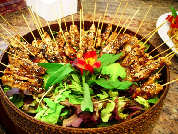 ... marinated chicken, skewered and grilled with a ginger sesame sauce